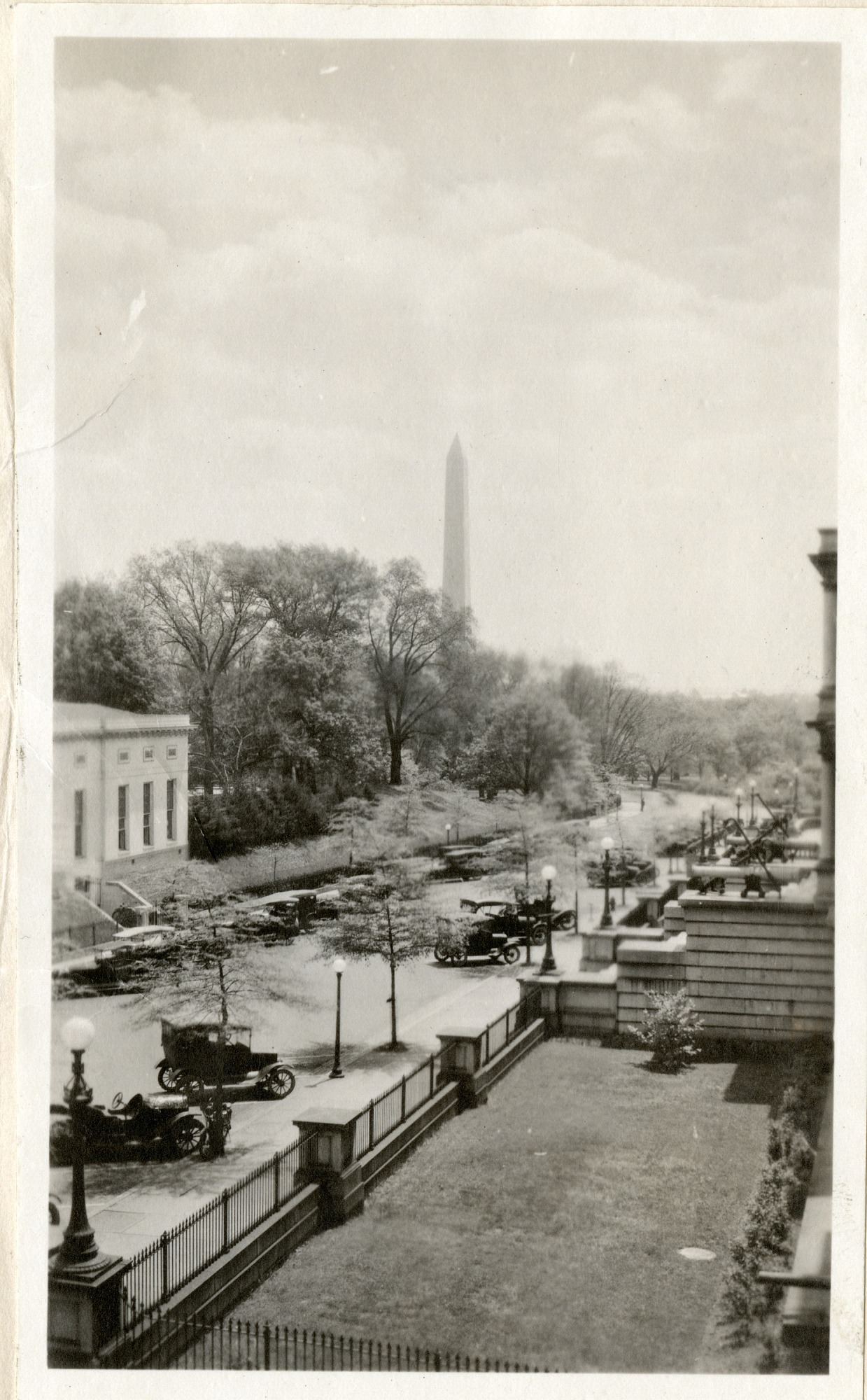 Street view with Washington Monument in the background