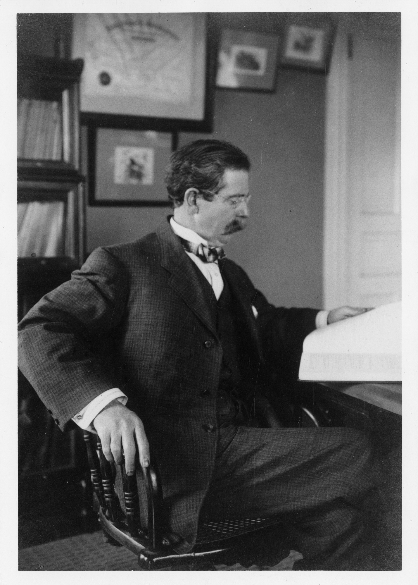 Robert Ridgway Sitting at a Desk