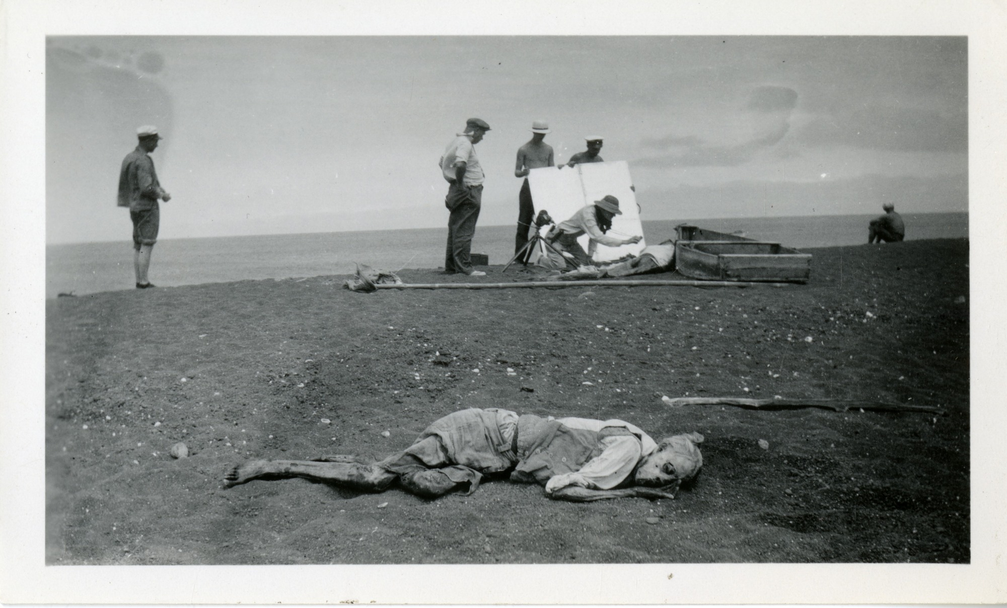 Body of Rudolph Lorenz, Velero crew with body of Captain Nygurrud in background [NOTE: Graphic Content]