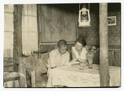 Margret Wittmer tutors her son, Harry, in their Charles Island home