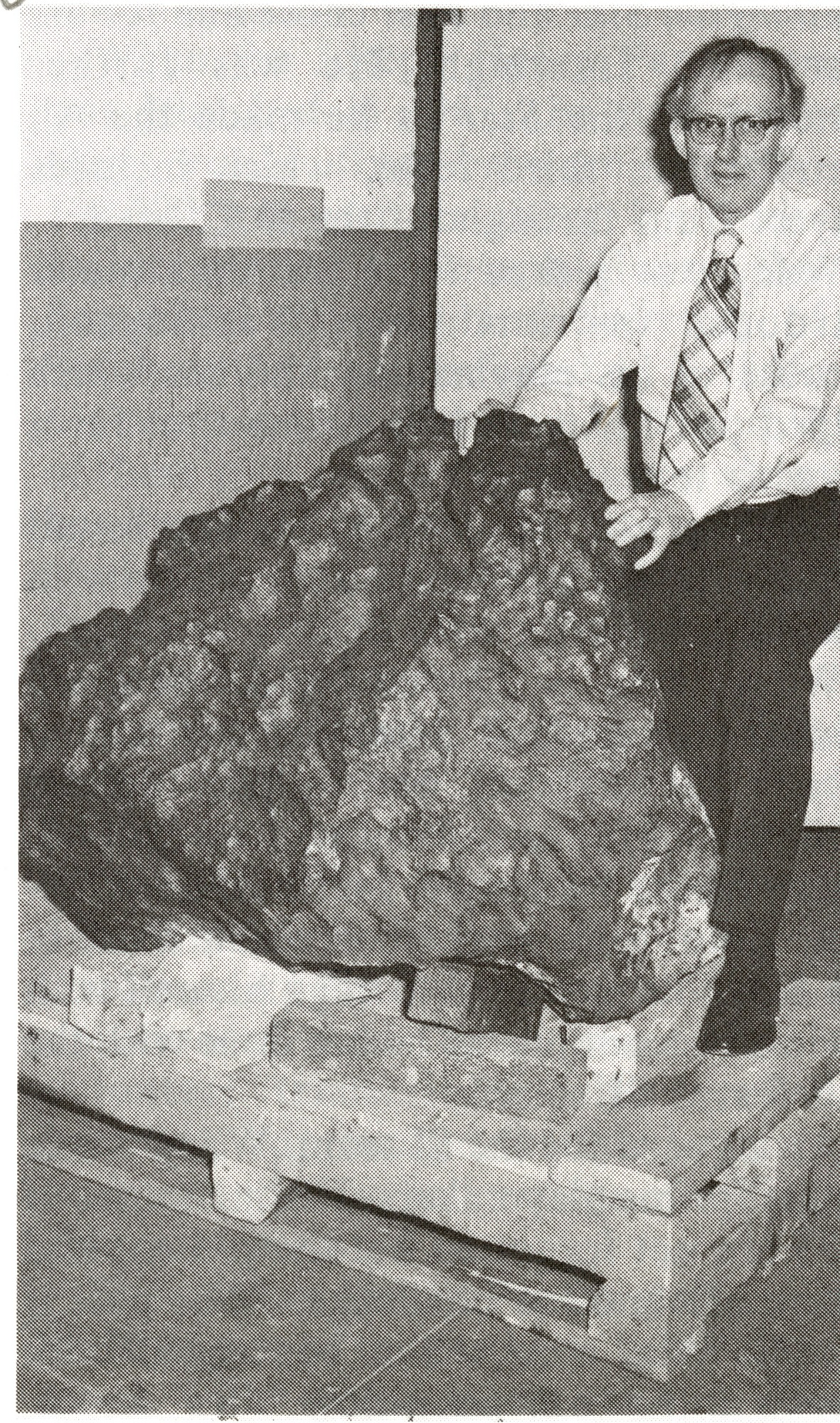 Curator Roy S. Clarke with Meteorite