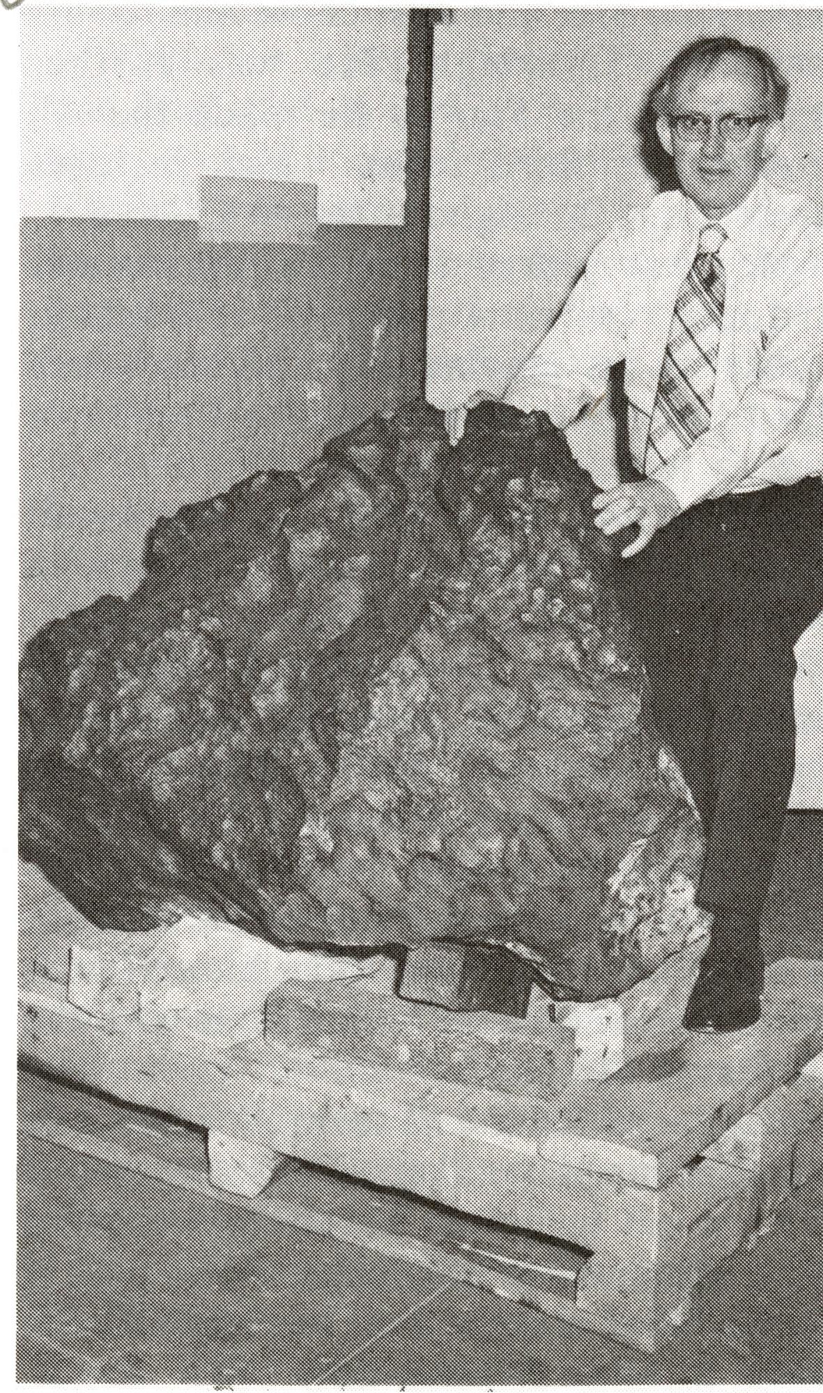 Curator Roy S. Clarke with Meteorite