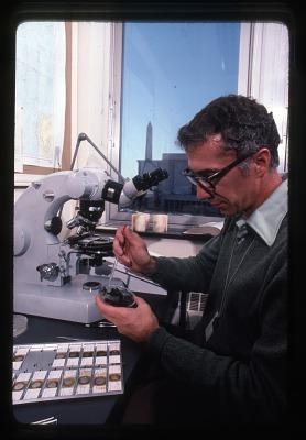 W. Duane Hope Holding a Petri Dish