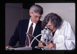 Roxie Laybourne and Doug Deedrick with Microscope