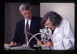 Roxie Laybourne and Doug Deedrick with Microscope