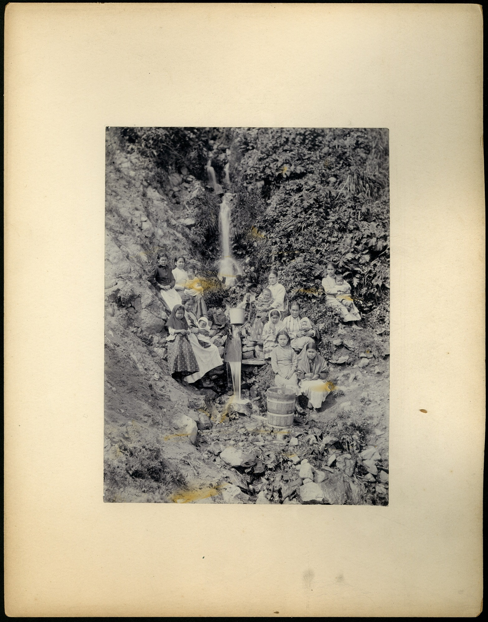 Unidentified women and children by waterfall