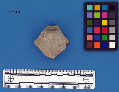 Stoneware lid sherd with center hole, gray salt-glazed