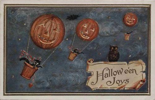 """Halloween Joys."" Three jack-o-lantern balloons flown by cats"