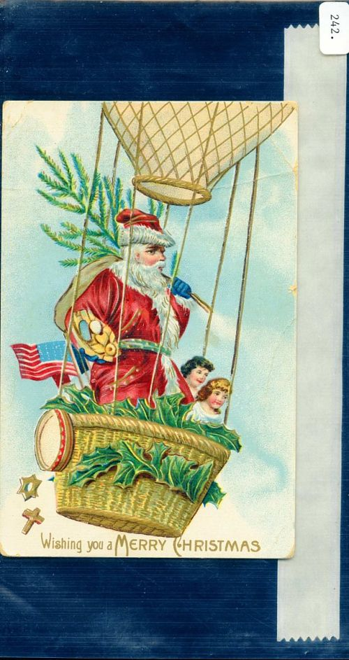 """""""Wishing you a MERRY CHRISTMAS."""" Santa Claus and two small children in a balloon"""