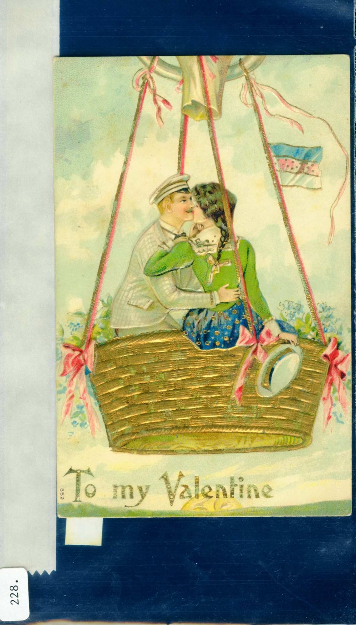 """""""To My Valentine."""" Handsome young couple kissing in balloon basket"""