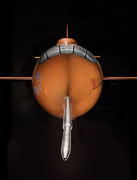 Front view of nose of an aircraft. The aircraft is painted orange.