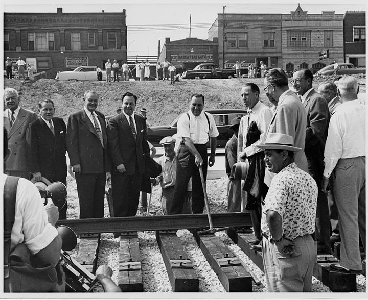 Mayor Richard J. Daley driving the first spike, Congress Expressway rapid transit line, Chicago, 1955