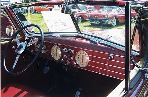 This 1936 Cadillac, like most cars of the 1930s, had a steel dashboard studded with knobs.