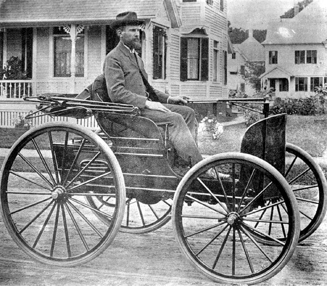 Charles E. Duryea sitting in the winning auto