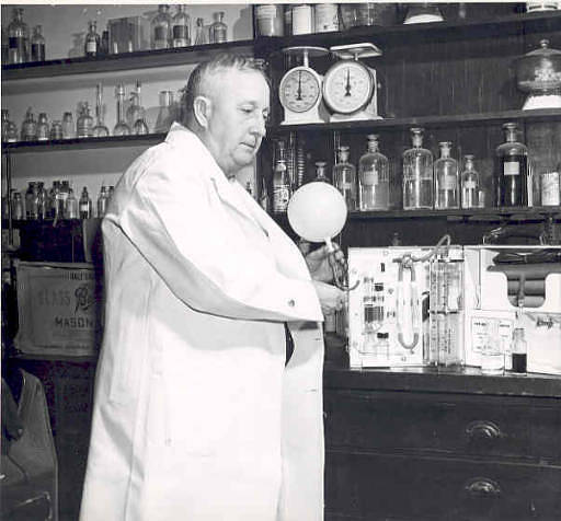 Dr. Rolla Harger displaying his