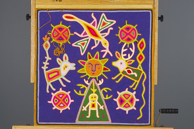 Yarn painting depicting the birth of the sun