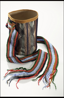 Basket worn at a woman's waist when digging roots
