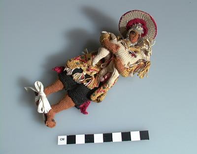 Male doll carrying a llama