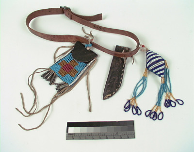 Girl's belt with knife sheath, belt bag, and umbilical amulet