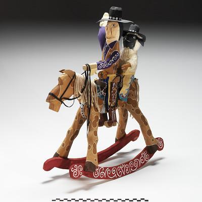 Cowboy and Sheep on Rocking Horse