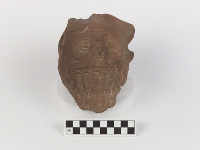 Figure part/fragment representing Tlaloc (the Rain God)