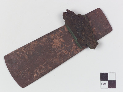 Axe with fragment of wooden handle