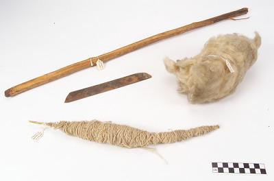 Weaving tools; batten, weaving sword, distaff and yarn, unspun wool