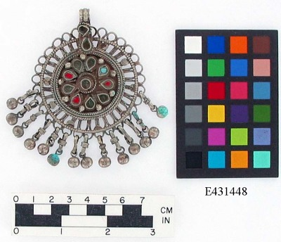 Round silver pendant with bells