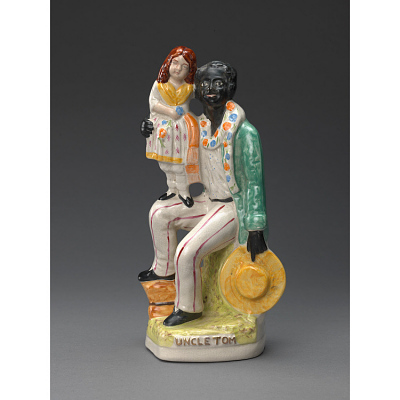 Staffordshire figurine of Uncle Tom and Little Eva