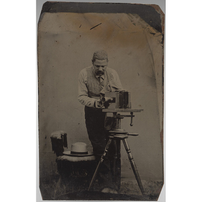 Unidentified photographer in field