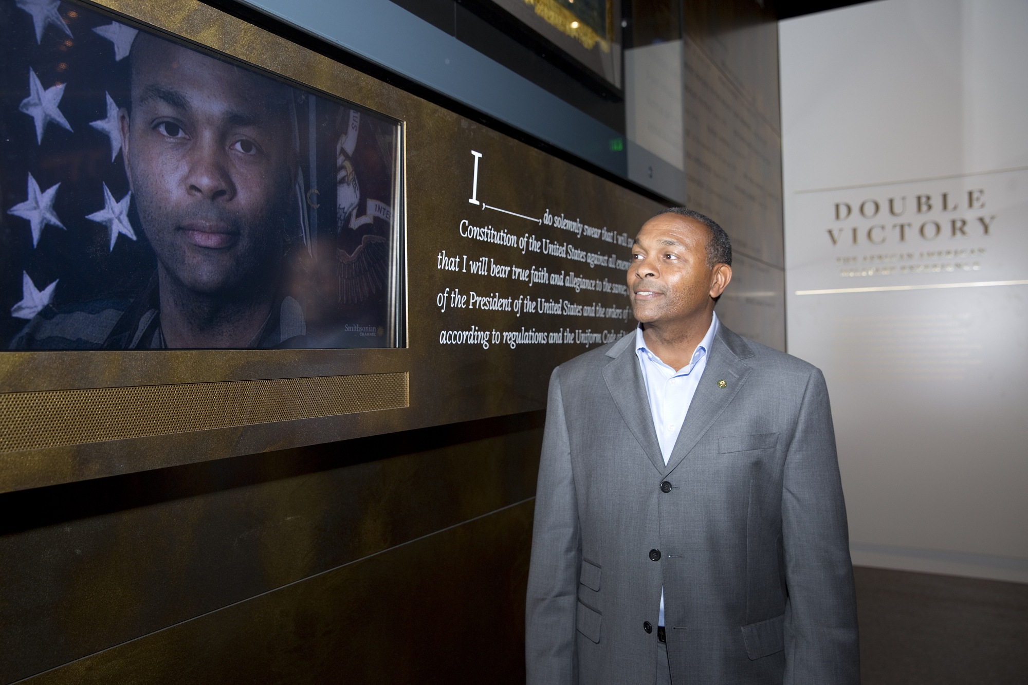 Visitor at Press Preview Featured in Military Exhibit, NMAAHC