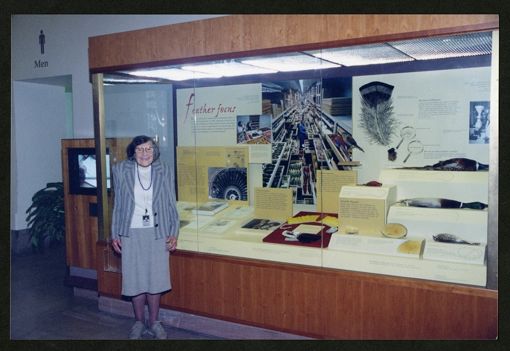 """image for Roxie Laybourne Stands in Front of """"Feather Focus"""" Exhibit Case"""