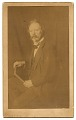 View Unidentified man holding a book digital asset number 0