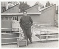 View Photograph of Diego Rivera on studio roof digital asset: verso