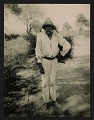 View Unidentified man carrying a bundle of sticks digital asset number 0