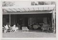 View Arnold Blanch and others on an outdoor patio digital asset number 0