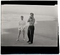 View Harry Bowden taking a photograph on the beach digital asset number 0