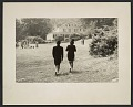 View Pat Adams and Patrick Ball walking in costume towards The Pines dining hall at Penland digital asset number 0