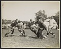 View Photograph of John Steuart Curry sketching a football practice at the University of Wisconsin-Madison digital asset number 0