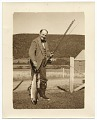 View Frank DuMond next to fence, holding a fish digital asset number 0
