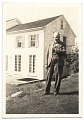View Frank DuMond standing by old farm house digital asset number 0
