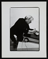 View Photograph of Andy Warhol writing on vacuum cleaner at <em>Art in Process V</em> exhibition digital asset number 0