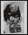 View Photograph of Andy Warhol writing a note on vacuum cleaner at <em>Art in Process V</em> exhibition digital asset number 0