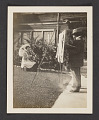 View Photograph of Frederick Carl Frieseke painting a woman outdoors digital asset: front