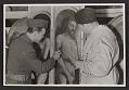 View Lieutenant Daniel J. Kern and Karl Sieber examining a panel of the Ghent Altarpiece digital asset number 0