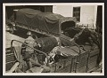 View George Stout and two unidentified men loading a truck at Altaussee, Austria digital asset number 0