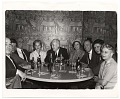 View Rockwell Kent and others sitting around a table digital asset number 0