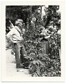 View John and Dolly Sloan in the garden of their Santa Fe ranch digital asset number 0