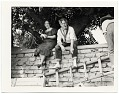 View John and Dolly Sloan seated on a wall at their Santa Fe ranch digital asset number 0