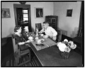 View Dolly and John Sloan seated at the table in their Santa Fe home digital asset number 0